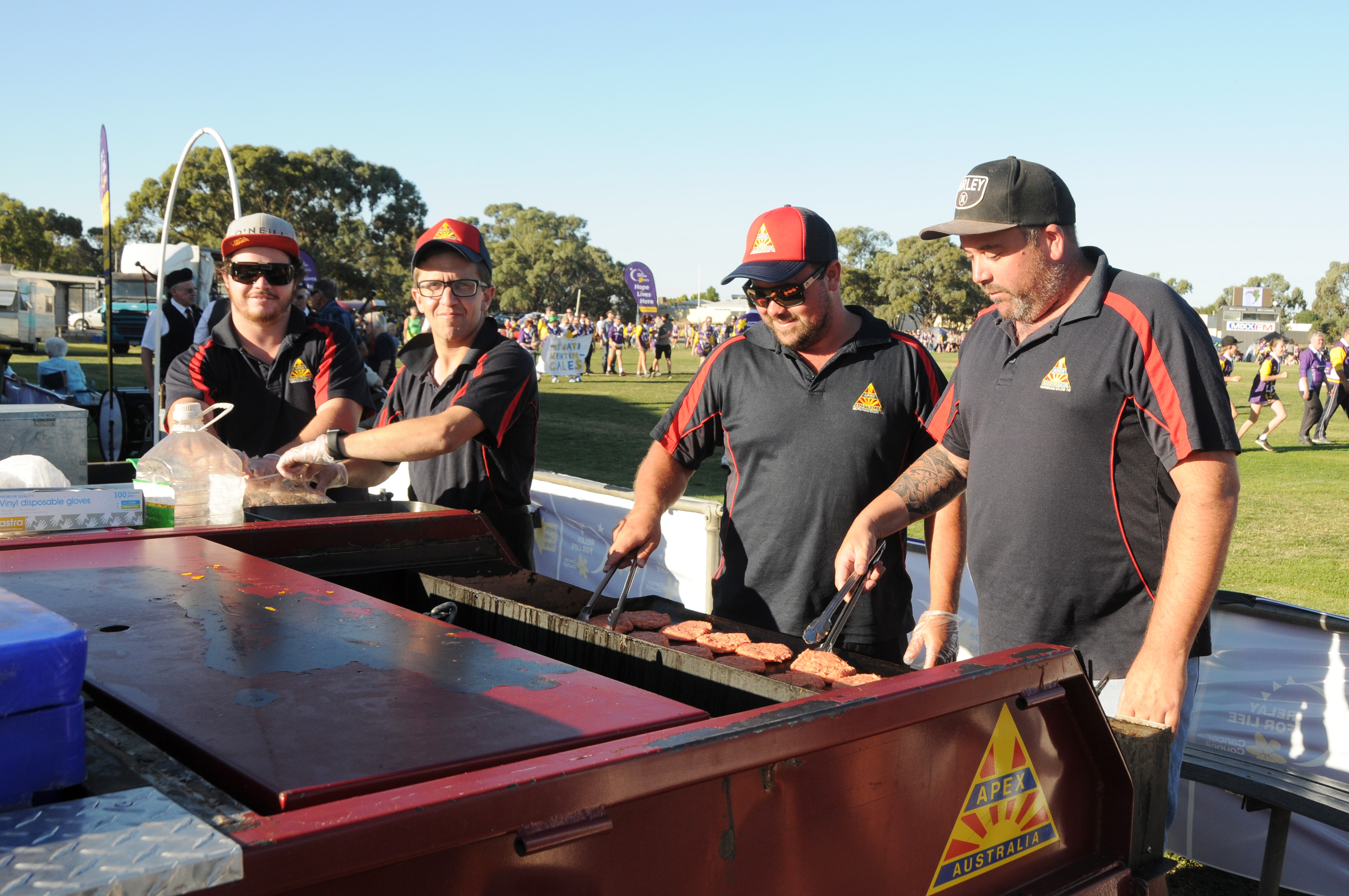 Image - Horsham and District Relay for Life, 170317. Club 15 Apex members Cam Dickerson, Stefan Phillips, Craig Clyne and Matthew Cross, president, working hard on the barbie. They later made a surprise donation to a lucky team.