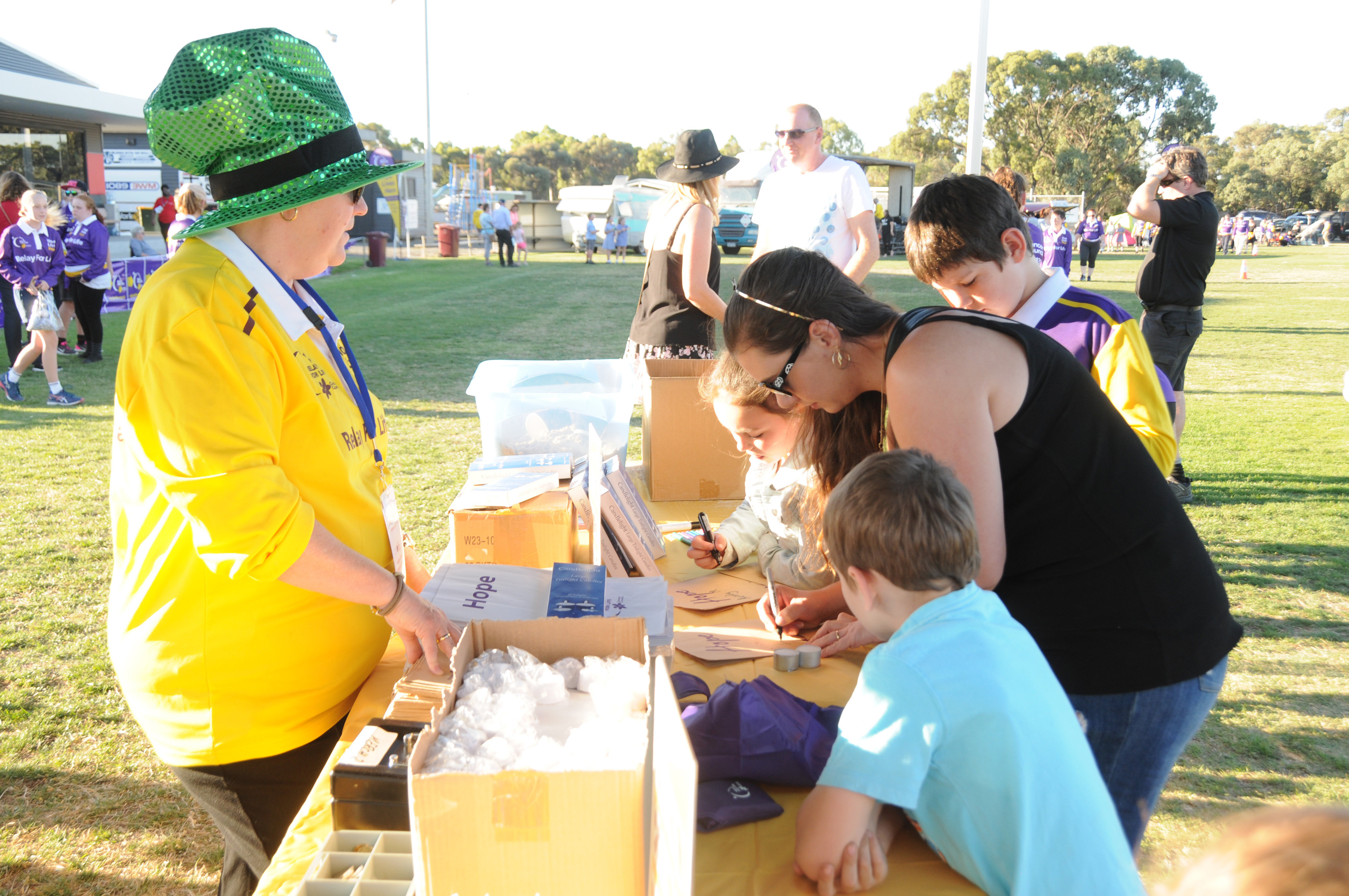 Image - Horsham and District Relay for Life, 170317. Mary Dalgleish, left, helps Ali Gregor create a memoriam for the candlelight ceremony.